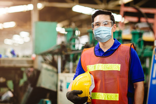 Working wearing a disposable face mask